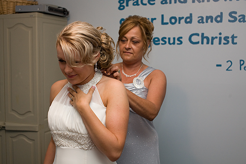 mother helping bride get ready
