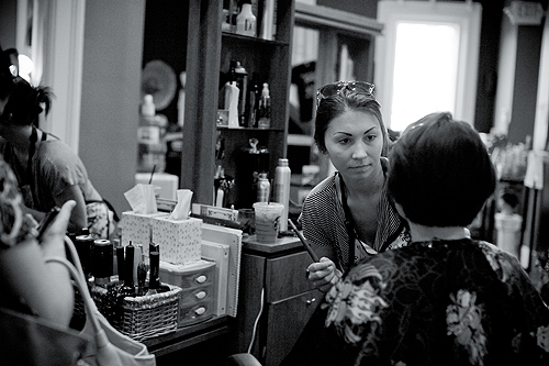 woman doing make-up at Shear Artistry in Louisville