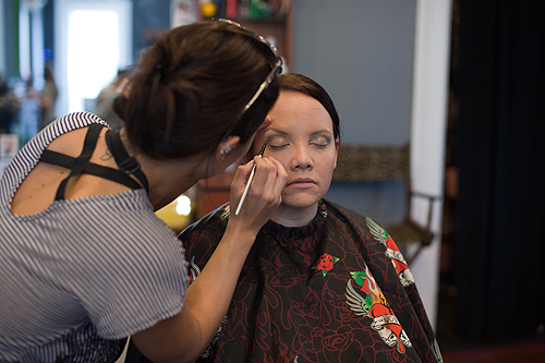 bride getting make-up done at Shear Artistry in Louisville